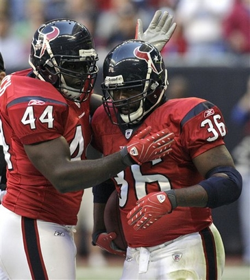 Houston Texans running back Ron Dayne (36) celebrates his touchdown run with teammate Vonta Leach (44) during the first quarter of their game, played Sunday afternoon.  Houston defeated Jacksonville 42-28.